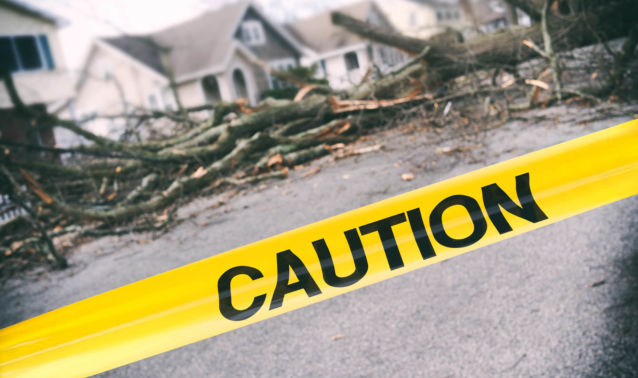 Caution tape in front of storm damage
