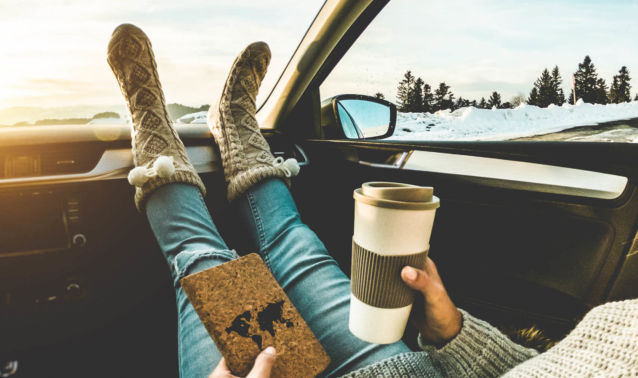 Socked Feet on Dashboard of car during winter