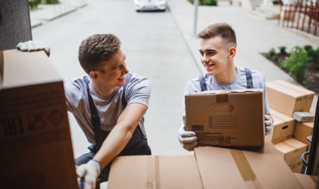 Two Young Men Unloading a Moving Truck