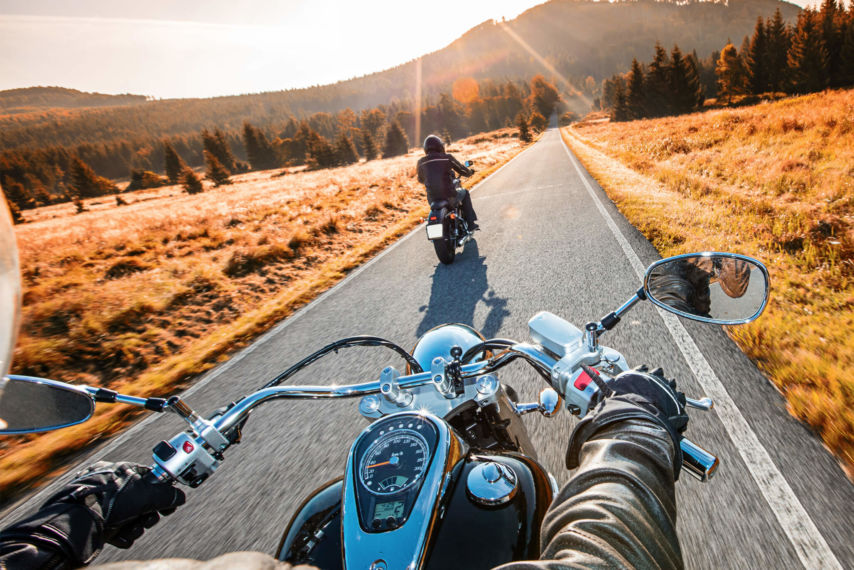 Motorcycle on open road in fall