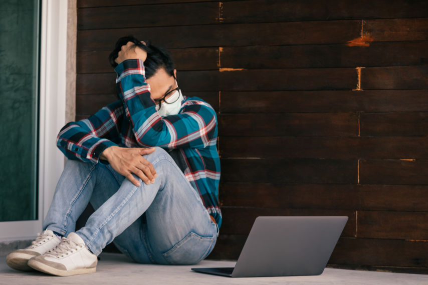 Young Man Wearing Mask With Laptop