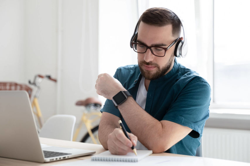 Young man at laptop with headphones