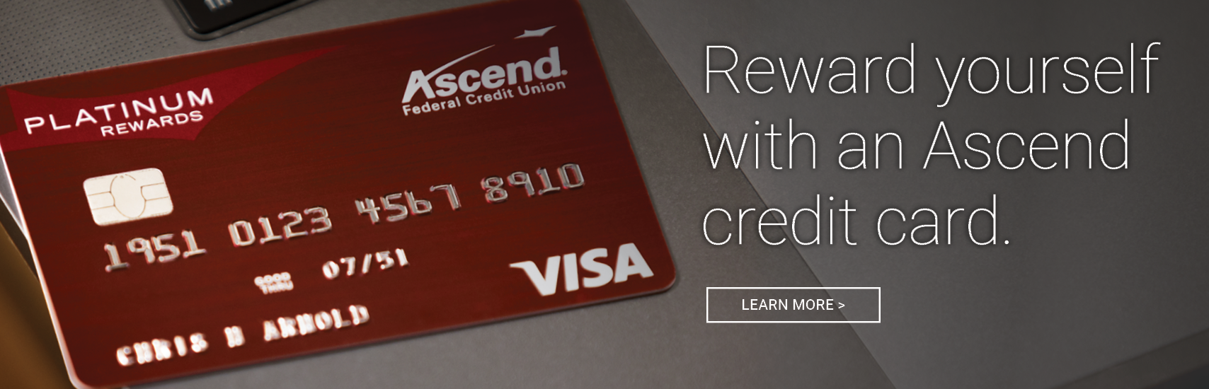 Red Ascend Visa Platinum Rewards card on a gray background