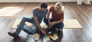 man and woman looking at new paint colors