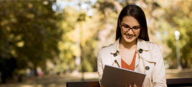 Young Woman on Park Bench with Laptop