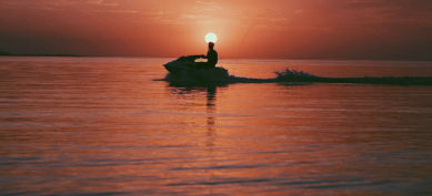 personal watercraft at sunset